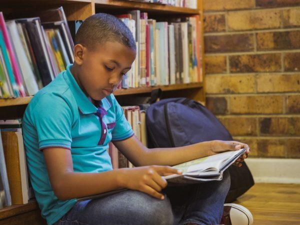 boy reading on